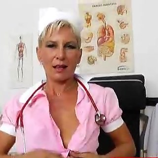 Blondie mama playing in addition to a gyn-tool