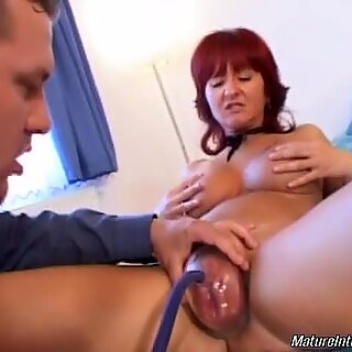 Redhead mature having kinky time with younger lover