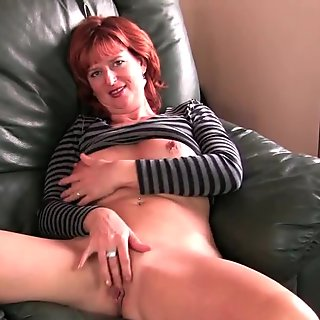 British mature Liddy masturbates on the couch