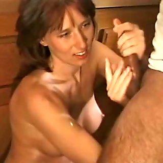 On her knees for handjob