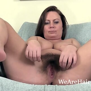 Alexis May unclothes bare on her blue chair