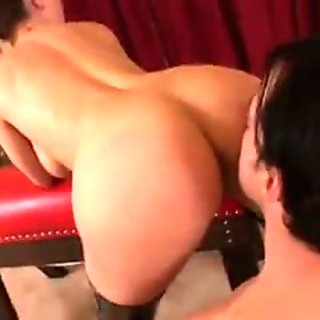 Sexy mistress in red leather dominates her three bitches