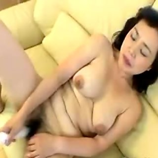 Old asian slut banging herself with a vibrator