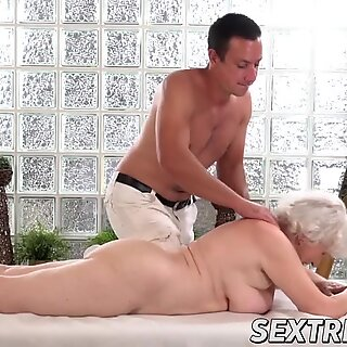 naughty granny Norma needs young rock hard trouser snake on a massage table