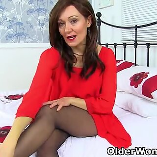 English milf Kitty Cream is your sexy lady in red without knickers