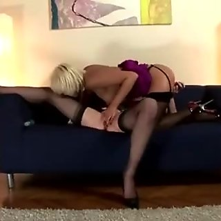 European lesbian in stockings gets dildo put in her pussy by mature