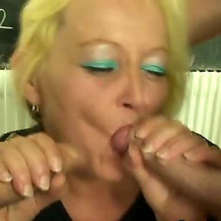 Mature teacher is pounded by two  pupils
