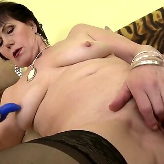 Classy granny feeding her mature pussy