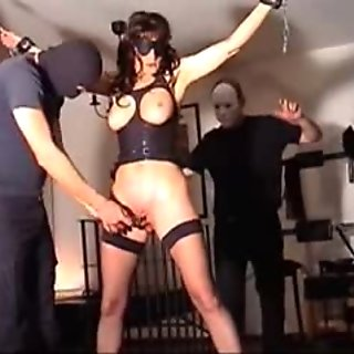 Mature brunette slave girl tied and dominated