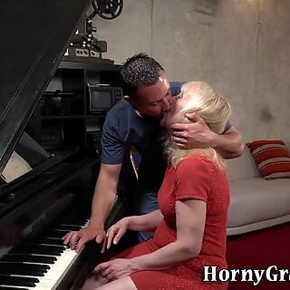 Ancient blonde rides cock