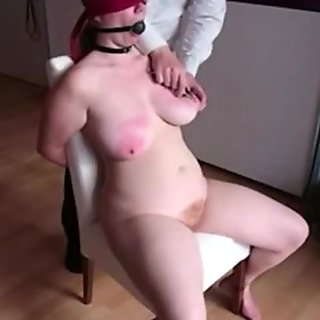 Bound up big beautiful woman bondman on the chair